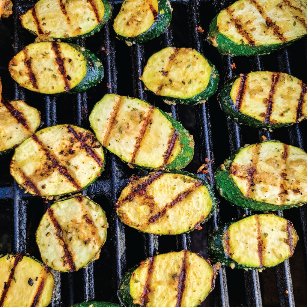 zucchini on the grill after being flipped over once