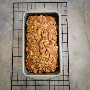Apple bread cooling down in the pan after baking.
