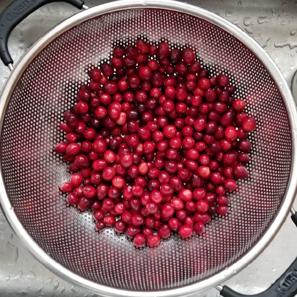 Fresh cranberries in a strainer