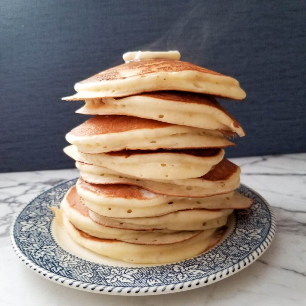 Large stack of pancakes after they have all cooked.