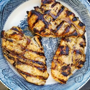 grilled chicken breasts on a plate