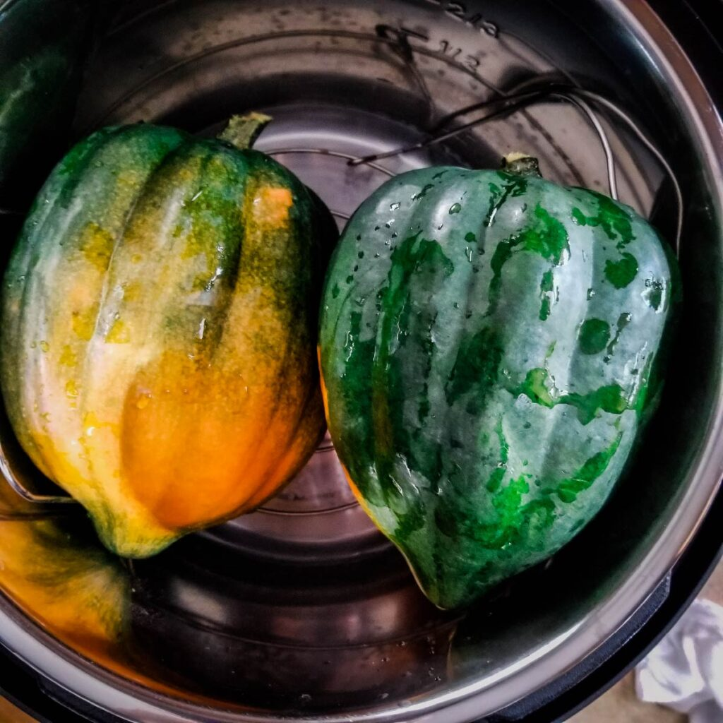 Two acorn squash rinsed off and ready to cook in the Instant Pot