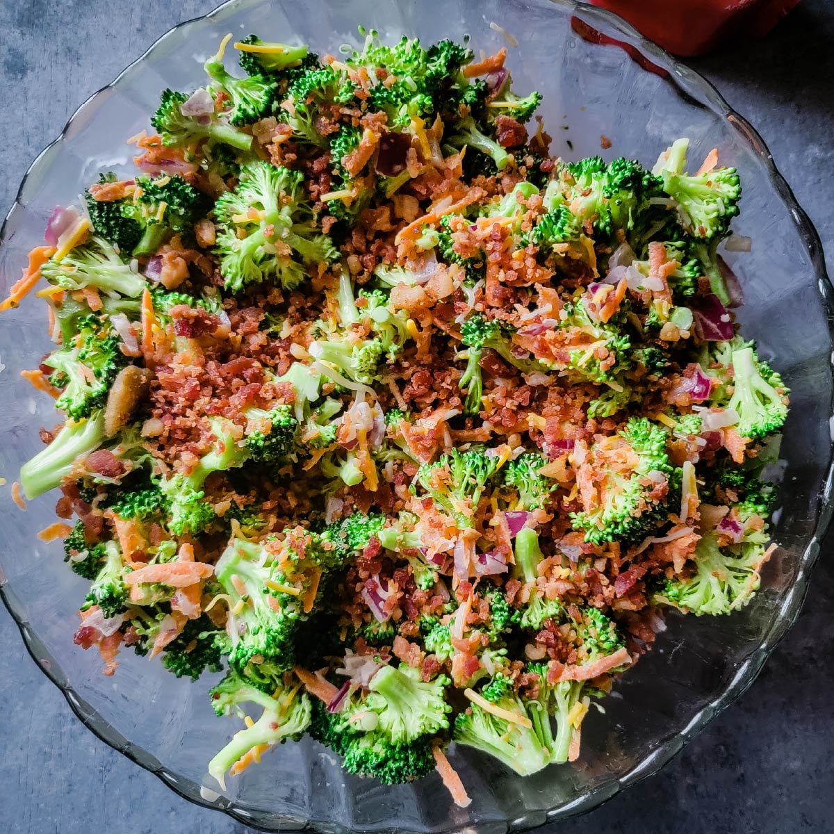 broccoli salad topped with bacon in a bowl to be served