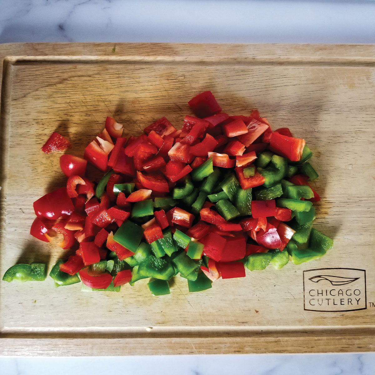 red and green bell peppers chopped on a cutting board