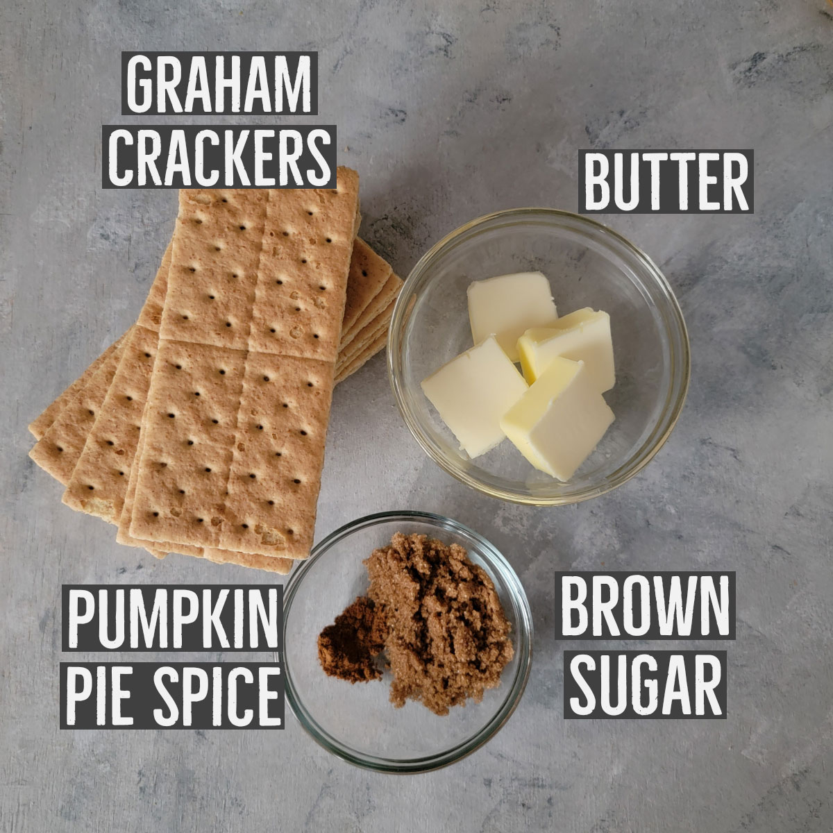 Ingredients shown for crust - graham crackers, butter, brown sugar and pumpkin pie spice.